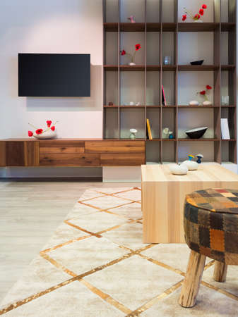 tv home: modern wood living room furniture with shelf and flat tv at wall
