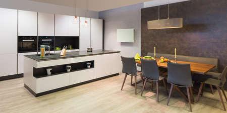 modern flat white kitchen with elegant wooden dinette