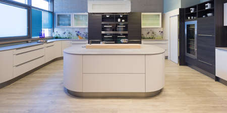 elegant modern kitchen with varnished and rounded front elements