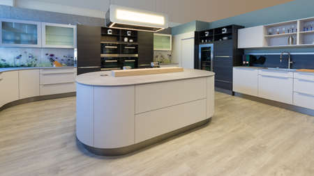 large designer kitchen with island rounded corners and lacquered fronts Stock Photo