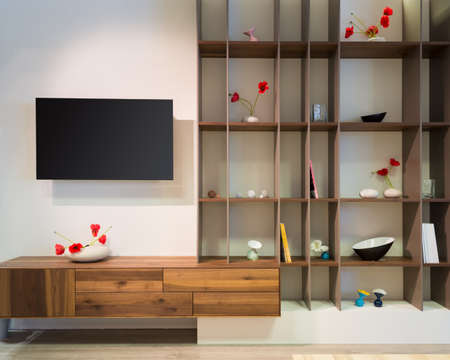 front view to living room wall withh wooden shelf and flat tv