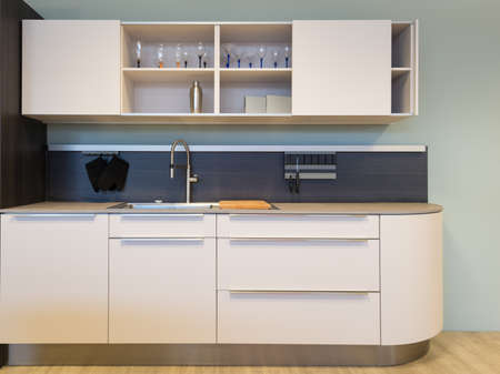 nice small beige kitchen kitchenet with sink and wall unit Stock Photo