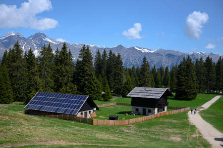sustainable photovoltaics houses in mountain alps at forest with blue sky Zdjęcie Seryjne