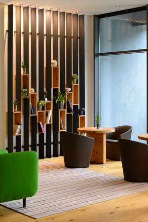 vertical metal shelf plant and book decoration on wooden boards boxes in indoor lobby