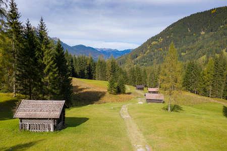 wooden farm huts on mountain meadow at fall autumn in tirol austria Imagens