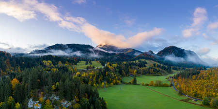 landscape with sky and mountain forest panorama at fall autumn in reutte austria Stock Photo
