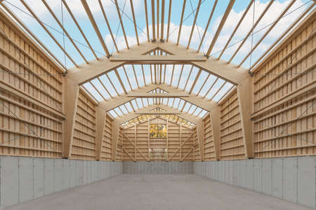 Interior of a large agricultural wooden hall during construction with an open roof