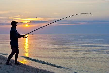 fishingpole: The siluette of single fisherman