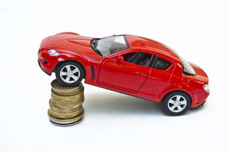 mazda: Money and red car on a white background isolated