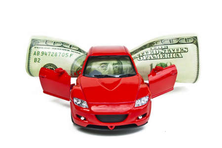 toy car: Money and red car on a white background isolated