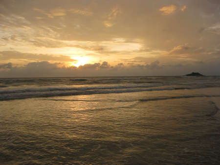 Sunset in Indian ocean with waves photo
