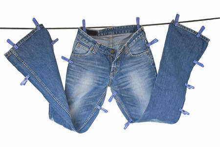 Blue jeans dry on washing line isolated on white photo