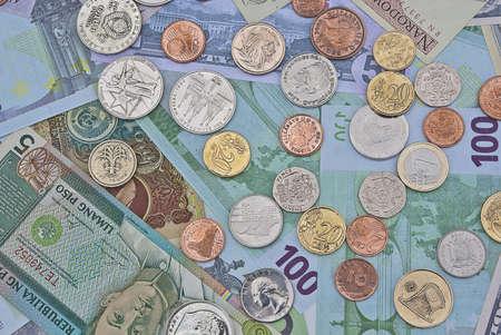 Banknotes and coins close up photo