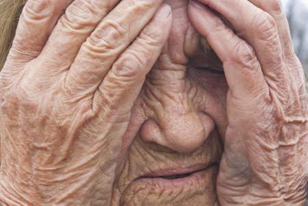 Senior woman is cry, closeup view photo