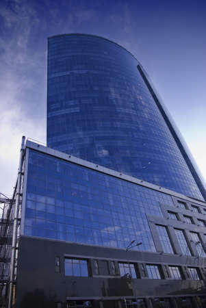 Exterior of the building in the city on a background of blue sky photo