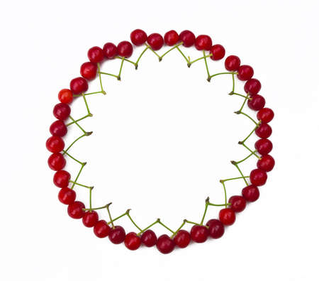 Round frame from cherries with place for text photo
