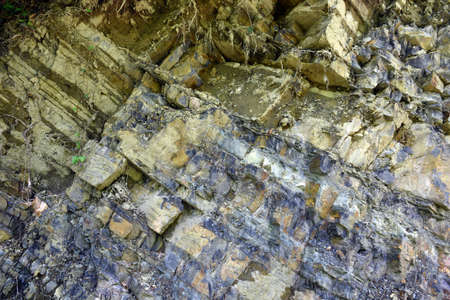 lithosphere: the cut section of the cliff with the collapse of the Stock Photo