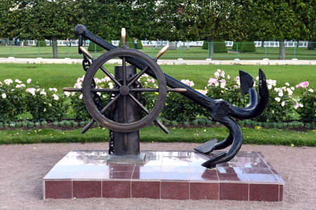 sculptural: The sculptural composition of anchor and steering wheel