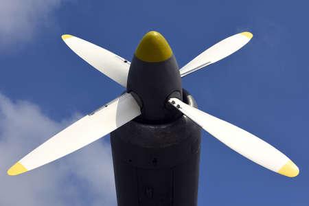 aluminum airplane: Airplane propeller against blue sky closeup Stock Photo