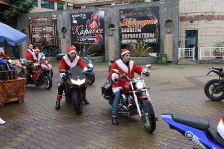 clauses: The parade of Santa clauses, a carnival procession and the celebration of New Year in Sochi, Russia, 24 December 2015. The area of the marine station.