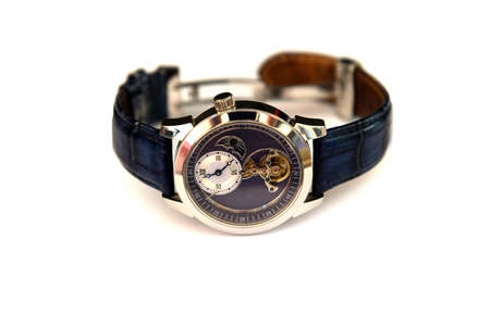 mechanical men: Mechanical men watch with blue dial, isolated on white background Stock Photo