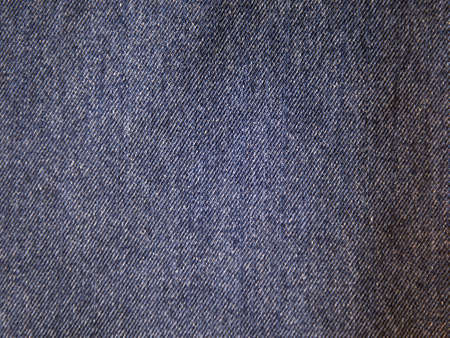 Blue denim texture and abstract background, close-up