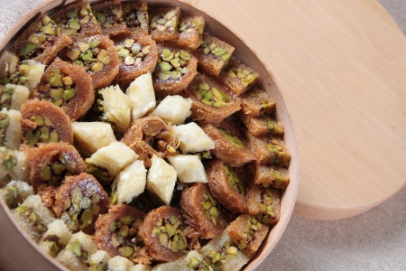 syria: Round Wooden box of a mix Arabic sweets (Mabroumeh)