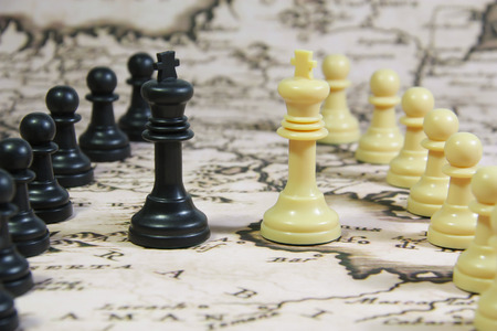 Chess Stones on a Map, whites agains blacks, and the kings facing each other in the middle