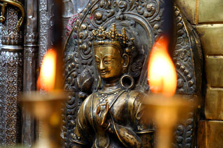 candlelight memorial: candles burning inside one of the Buddhist temples in Nepal Stock Photo