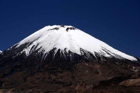 Snowcapped Parinacota volcano in Park Lauca in Chile Stock Photo - 5079268