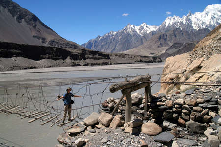 Unstable bridge across Hunza river in Karakorum photo