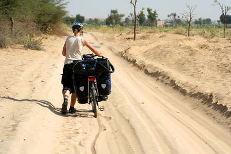 Cycling through remote desert road in India