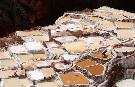 Traditional salt mine ( salinas ) in Maras in Peru Stock Photo