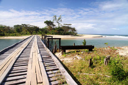 Small wooden bridge on the rural road to Maroantsetra photo