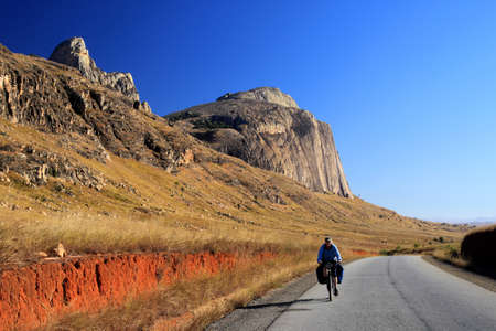 Woman cycling solo through beautiful Madagascar countryside