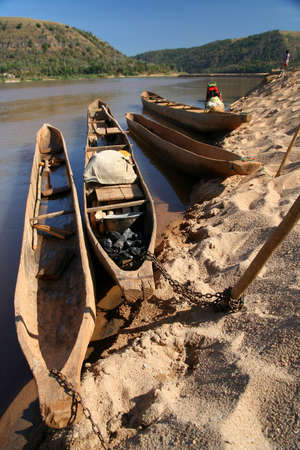 Traditional african pirogues on the Tsiribihina river in Madagascar Stock Photo - 8523110