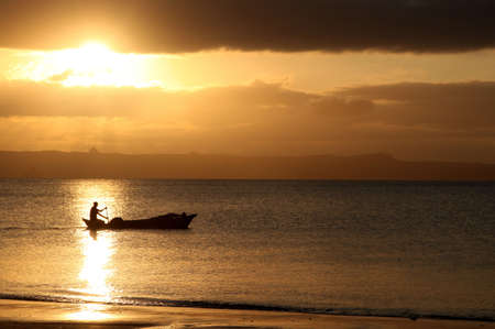 Traditional fishing pirogue at sunset  in the Anakao village in Madagascar Imagens