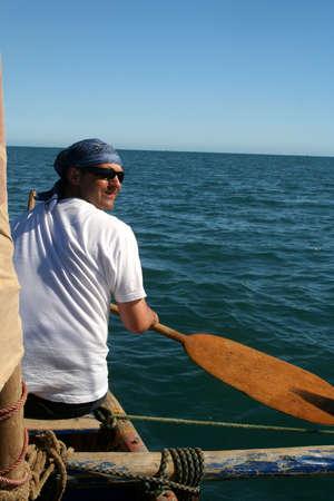 Man paddling in the ocean on Madagascar coast Stock Photo - 8544401