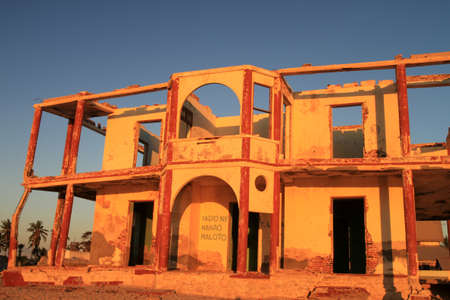 Delapidated building on the coastal town Morondava � every year sea claims more and more land in this area of Madagascar contributing to the destruction of seaside resorts � lots of them already abandoned and left to the element photo