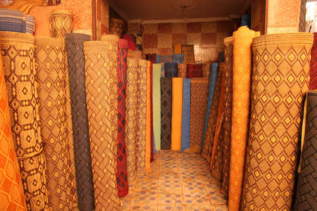 Carpets on sale on the stand in the medina in Fes, Morocco Stock Photo - 13053384