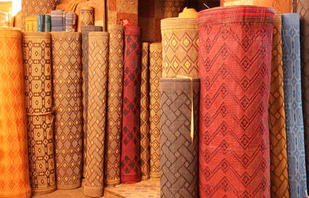 Carpets on sale on the stand in the medina in Fes, Morocco photo
