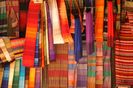 Scarfs on sale on the stand in the medina in Fes, Morocco Imagens