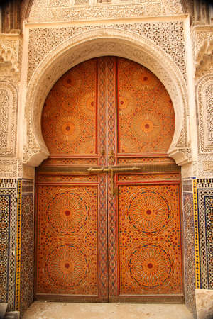 Traditional entry door in the medina, Morocco photo