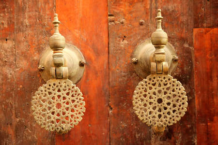 Traditional door handles to the home in the Fes medina, Morocco 写真素材