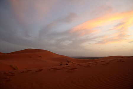 Sunset over spectacular sand dunes in Merzouga, Morocco photo