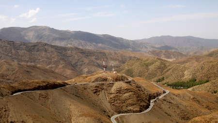 Road from Ouarzazate to Marrakesh through Atlas mountains photo