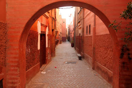 Narrow street in the medina in Marrakesh, Morocco photo