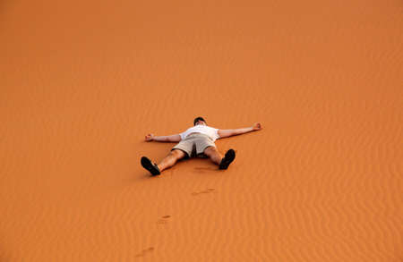 Tourist having a great time among the stunning sand dunes of Sahara desert in Merzouga, Morocco photo