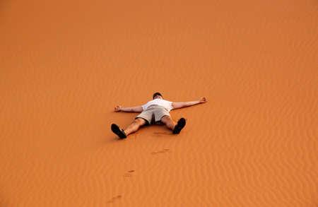Tourist having a great time among the stunning sand dunes of Sahara desert in Merzouga, Morocco Stock Photo - 13106299