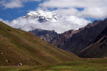 aconcagua: Aconcagua – highest peak In South America covered In clouds